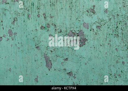 Close up peeling paint on a concrete wall, cracked paint background, old house walls exterior - Stock Photo