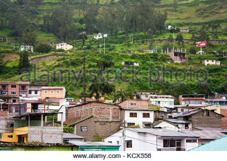 Low rise constructions in traditional Andean town. Scenic view of a hill town with buildings and lush greenery scattered - Stock Photo
