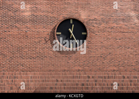 A Vintage Station Clock On A Red Brick Wall With Copy Space - Stock Photo