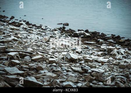 stones and rocks at a river on a cold winter day - Stock Photo