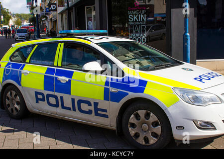 A PSNI police patrol car cruising the pedestrian zone in the Diamond in Coleraine, Northern Ireland - Stock Photo
