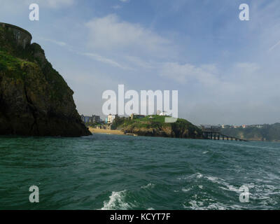 Looking back to popular seaside resort of Tenby Pembrokeshire South West Wales from tourist boat on Carmarthen Bay - Stock Photo