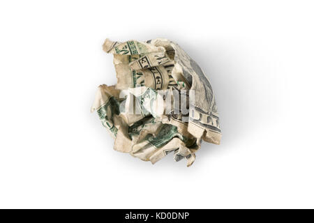 A crumpled up dollar bill on white with shadow, 'trash' or 'throwing money away' concept - Stock Photo