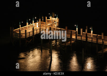 The dock t the Sanibel harbour resort lit up at night in Ft. Meyers, FL - Stock Photo