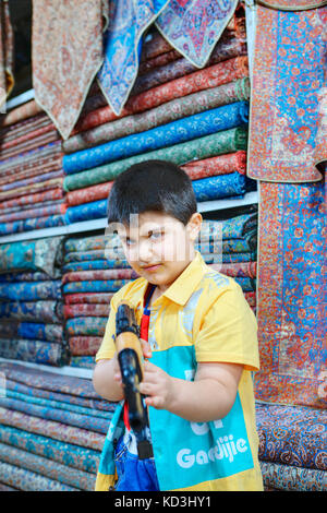 Fars Province, Shiraz, Iran - 19 april, 2017: One unknown boy, about 10 years old, plays with a Kalashnikov toy - Stock Photo
