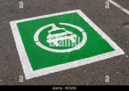 Electric Vehicle designated parking spot - Stock Photo