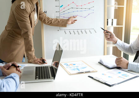 presentation in business group meeting show chart graph on board - Stock Photo