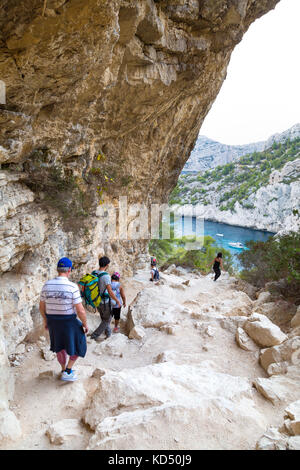 Group of people hiking to the Calanque de Sugiton, Calanques National Park, France - Stock Photo