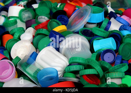 Plastic bottles tops ready to be recycled. Sustainability and recycling theme - Stock Photo