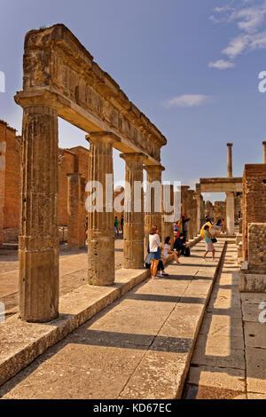 Columns at the Forum area in the ruined Roman city of Pompeii at Pompei Scavi near Naples, Italy. - Stock Photo