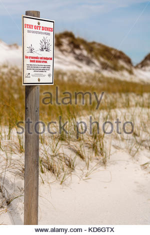 Sign requesting we all stay off the sand dunes along the Florida Gulf Coast, as the grasses grow to aid dune stabilization - Stock Photo