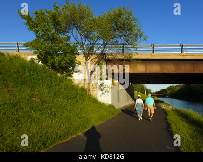 Senior couple walking along the Erie Canal. - Stock Photo