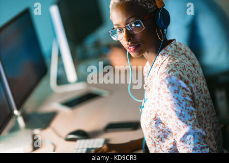 Portait of software designer working in office - Stock Photo