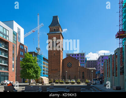 Cutting Room Square and the restored former church of St. Peter (now a rehearsal space for the Hallé Orchestra), - Stock Photo