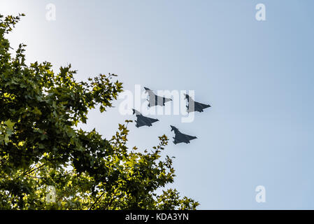 Madrid, Spain. 12th Oct, 2017. Four Eurofighter jet flying in Spanish National Day Parade. Short after the parade - Stock Photo