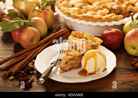 Piece of an apple pie with ice cream on a plate - Stock Photo