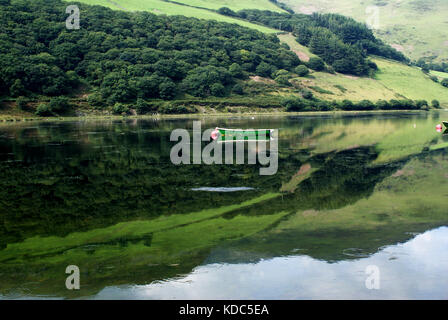 single boat on lake in wales - Stock Photo