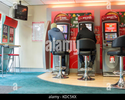 Fixed odds betting terminals in bookmakers. England. UK - Stock Photo