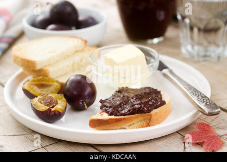 Toasts with plum chocolate jam. Breakfast in the garden. Rustic style, selective focus. - Stock Photo