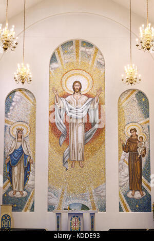 Two storey mosaic of crowned Mary, the risen Lord Jesus Christ and Saint Anthony of Padua in the Mausoleum Chapel - Stock Photo