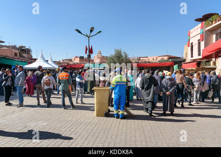 Marrakech, Morocco - December 28, 2017: ?rowd of people are waiting for the king on square in medina in Marrakesh - Stock Photo