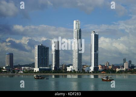 Day view of Panama City Over Panama Bay with skyline and a fishing boat on the foreground - Stock Photo