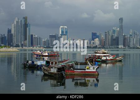 Panama City - view Over Panama Bay with skyline and fishing boats on the foreground - Stock Photo