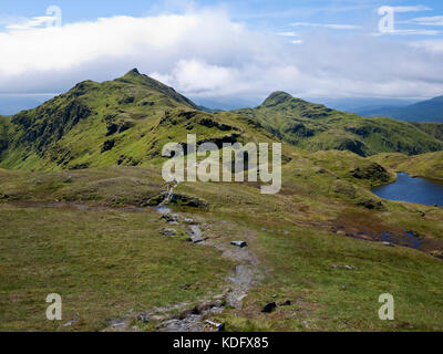 View along the Tarmachan Ridge from Meall nan Tarmachan to Meall Garbh (L) and Beinn nan Eachan (R) - Stock Photo