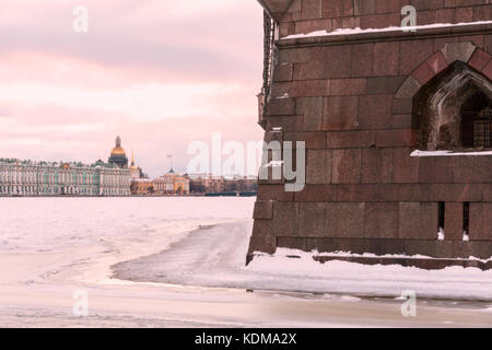 Landmark in Saint Petersburg, Russia: the Peter and Paul fortress wall by a winter day, the Neva river covered by - Stock Photo