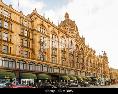 Exterior of Harrods, the luxury department store on Brompton Road in Knightsbridge, Royal Borough of Kensington - Stock Photo