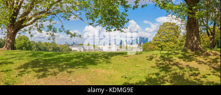 London - The panorama of the Canary Wharf and the City from Greenwich park. - Stock Photo