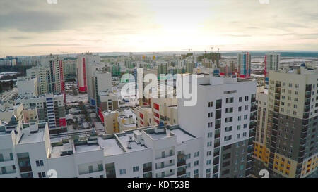 Aerial view on residential area. A newly completed housing estate in a summer setting. Aerial new estate with neighborhood - Stock Photo