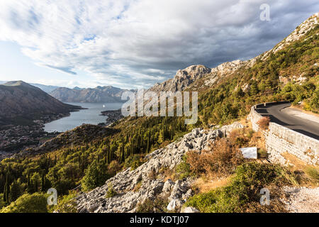 Mountain road above the Kotor bay and old town in Montenegro in the Balkans, Southeastern Europe - Stock Photo