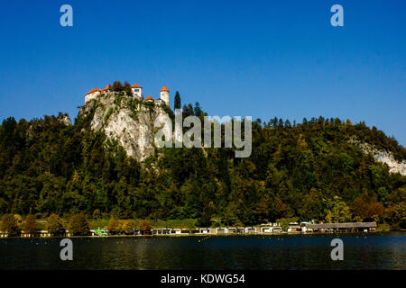 Bled Castle, in a rock near the lake and its famous island, Slovenia - Stock Photo
