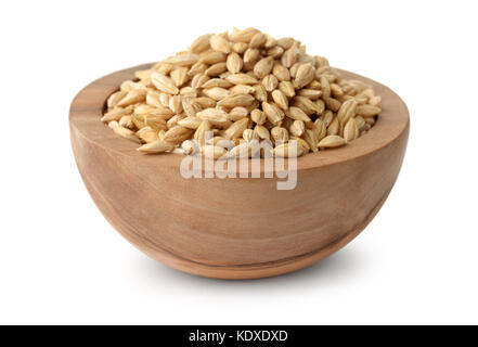 Wooden bowl of barley grains isolated on white - Stock Photo