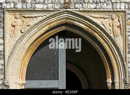 A view of the spandrels above the entrance door in the south porch of the church of St Peter at Ringland, Norfolk, - Stock Photo