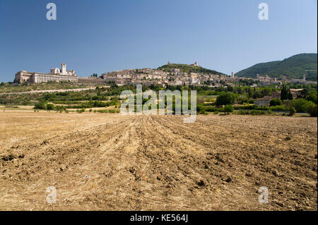 City of Assisi with Romanesque and Italian Gothic Franciscan friary Sacro Convento Basilica Papale di San Francesco - Stock Photo