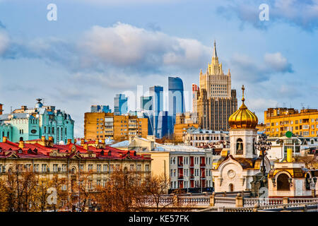 View of Moscow city on a sunny autumn day. Old and new houses, small historic buildings and a modern skyscrapers - Stock Photo
