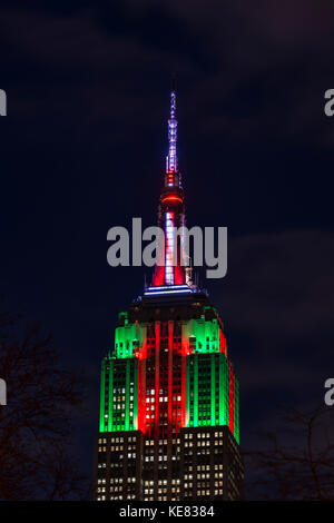 Empire State Building In Christmas Colours; New York City, New York, United States Of America - Stock Photo