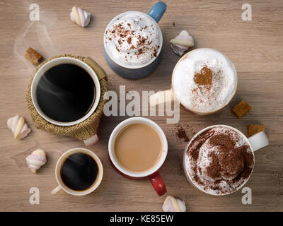 Cups of different kinds of coffee drinks as family or friendly company symbol. Everybody finds his own kind of coffee. - Stock Photo