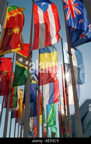 A colourful sea of flags welcomes visitors at International Tourism Fair, ITB, in front of Berlin Congress Center, - Stock Photo