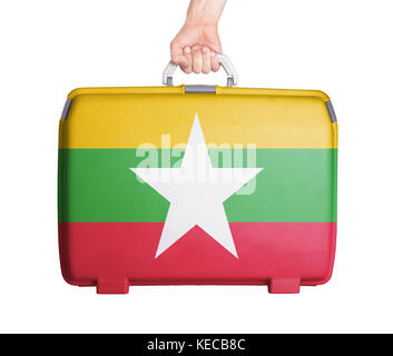 Used plastic suitcase with stains and scratches, printed with flag - Myanmar - Stock Photo