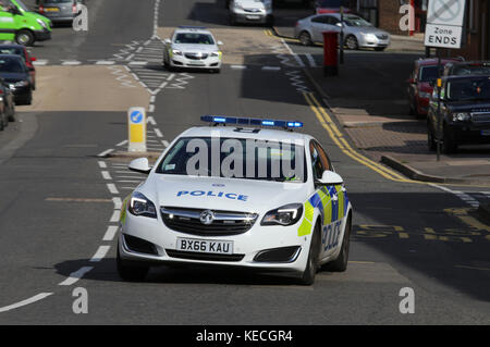 A West Midlands Police emergency response car, responding to a 999 call, near Birmingham city centre, UK, in 2017. - Stock Photo