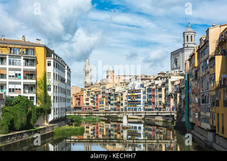 Residential houses along the river Onyar with a view of the sights in the city of Girona (Spain, Catalonia) - Stock Photo