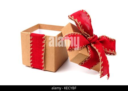Opened brown gift box wrapped with rustic red bow and ribbon isolated on white - Stock Photo