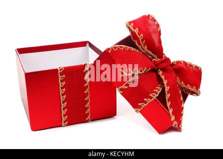 Opened red gift box wrapped with rustic red bow and ribbon isolated on white - Stock Photo