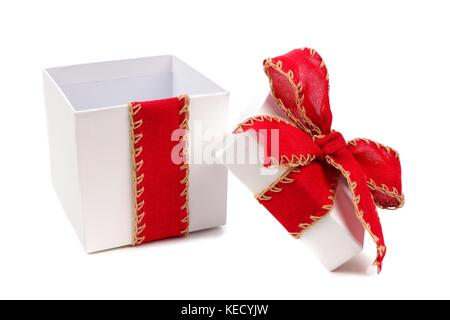 Opened white gift box wrapped with rustic red bow and ribbon isolated on white - Stock Photo