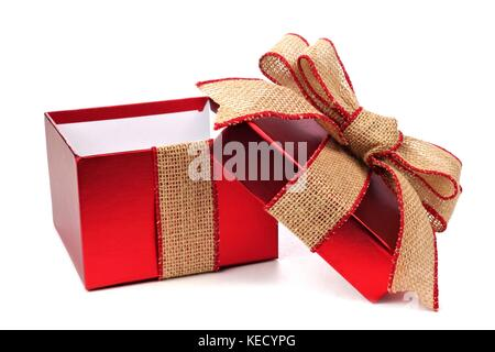 Opened red gift box wrapped with rustic burlap bow and ribbon isolated on white - Stock Photo