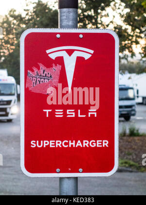 Tesla supercharger signboard at a petrol station in Bavaria, Southern Germany, October 2017 - Stock Photo