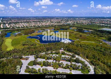 Florida Boynton Beach Green Cay Nature Center & Wetlands aerial overhead bird's eye view above residential neighborhood - Stock Photo